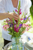 Woman arranging summer bouquet