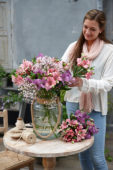 Lady making summer bouquet