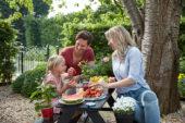 Family enjoying strawberries