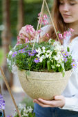 Young lady with hanging basket