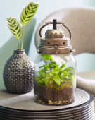 Decorative lantern with ferns