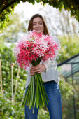 Young lady with Nerine flowers