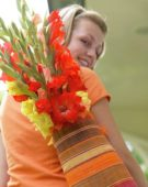 Woman with Gladiolus in bag