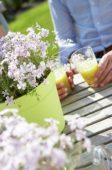 Couple relaxing at garden table