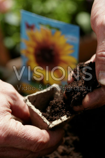 Filling jiffy pot with soil