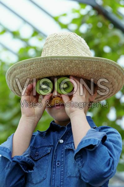 Boy with kiwi fruit