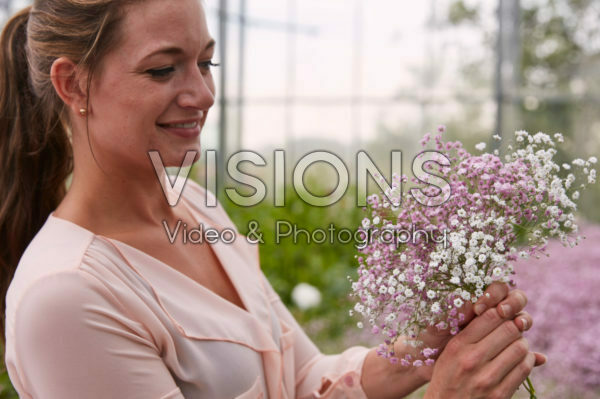 Lady holding Gypsophila bouquet