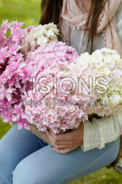 Lady with hydrangea flowers