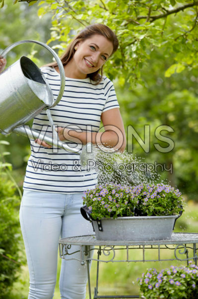 Lady watering plants