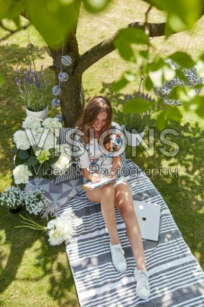 Lady working under tree