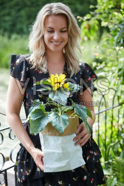 Lady holding sunflower