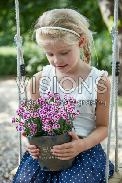 Girl holding dianthus