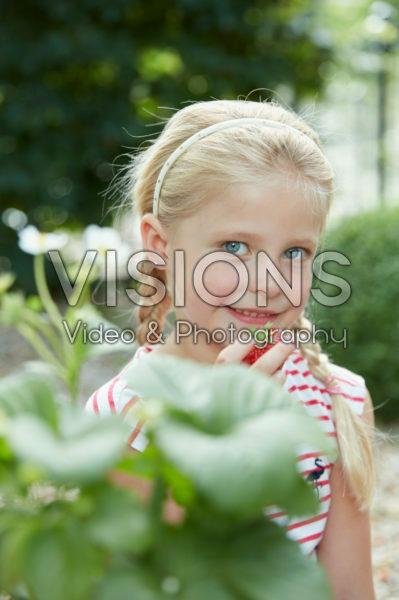 Girl eating strawberry