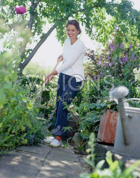Woman working in summer garden