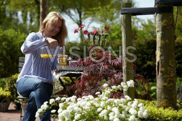 Woman relaxing in garden
